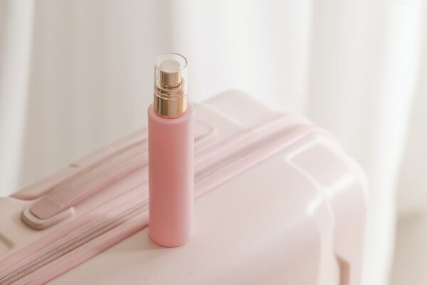 Pink cosmetic bottle beauty product still life