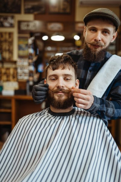 Barber and customer with a mustache, barbershop