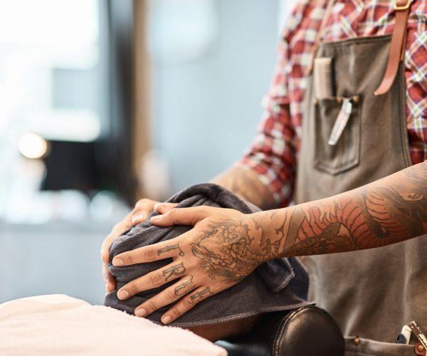 Professional barber using a towel